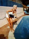 American Actress Jayne Mansfield with a Bottle of Champagne  Near a Swimming Pool  1956-1957