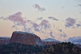 Pink Clouds at Dawn over Sandstone Formations Covered with a Dusting of Snow