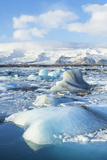 Mountains Behind the Icebergs Locked in the Frozen Water of Jokulsarlon Iceberg Lagoon