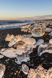 Broken Ice from Washed Upiicebergs on Jokulsarlon Black Beach at Sunrise