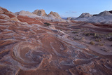 Red and White Sandstone Swirls at Dawn