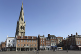 The Spire of St Mary Magdalene Church Rises over Building on the Market Square