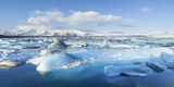 Panorama of Mountains and Icebergs Locked in the Frozen Water