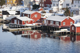 Wooden Cabins at the Waters Edge in the Town of Raine in the Lofoten Islands  Arctic  Norway