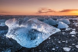Broken Ice from Washed Up Icebergs on Jokulsarlon Black Beach at Sunset