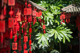 Red Wooden Buddhist Good Luck Charms and Tropical Vegetation  Hangzhou  Zhejiang  China