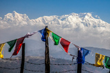 Colored Prayer Flags Flutter in Front of the Majestic Kanchenjunga