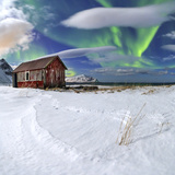 Northern Lights (Aurora Borealis) over an Abandoned Log Cabin Surrounded by Snow
