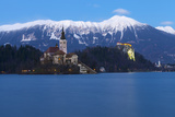 The Assumption of Mary Pilgrimage Church on Lake Bled and Bled Castle at Dusk  Bled  Slovenia