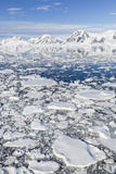 Snow-Covered Mountains Line the Ice Floes in Penola Strait  Antarctica  Polar Regions