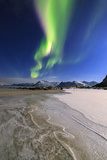 The Northern Lights (Aurora Borealis) Light Up the Sky and the Beach of the Cold Sea of Gymsoyand