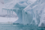 Wind and Water Sculpted Iceberg with Icicles at Booth Island  Antarctica  Polar Regions