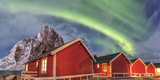 The Green Light of the Northern Lights (Aurora Borealis) Lights Up Fishermans Cabins
