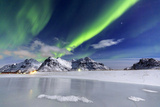 Northern Lights (Aurora Borealis) Illuminate the Sky and the Snowy Peaks