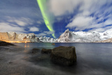 Northern Lights (Aurora Borealis) Illuminate Hamnoy Village and Snowy Peaks