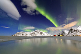 Northern Lights (Aurora Borealis) Reflected in the Cold Waters