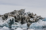 Iceberg with Moraine Material and Icicles at Booth Island  Antarctica  Polar Regions