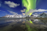Northern Lights (Aurora Borealis) and Mountains Reflected in the Cold Waters