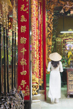 Woman Wearing Ao Dai Dress at Phuoc an Hoi Quan Pagoda  Cholon  Ho Chi Minh City  Vietnam