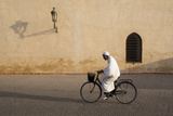 Muslim Man Dressed in White on Bicycle in Old Quarter  Medina  Marrakech  Morocco