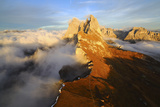 Aerial Shot from Seceda of Odle Surrounded by Clouds at Sunset in the Dolomites
