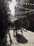 A Rickshaw Driving Through the Streets of Kathmandu  Nepal  Asia