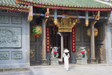 Woman Wearing Ao Dai Dress at Nghia an Hoi Quan Pagoda  Cholon  Ho Chi Minh City  Vietnam
