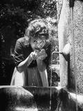 Actress Sophia Loren Drinking Water from Spigot