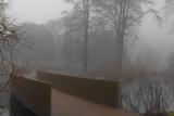 Royal Botanic Gardens  Kew  London the Sackler Crossing in Fog with Winter Trees