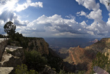 Grand Canyon  Arizona  with the Sun Breaking Though a Dramatic Cloudy Sky