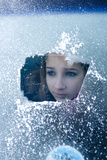 Girl Smiles Behind Frosted Window