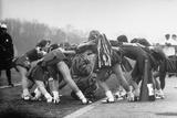 Hempstead High School Cheerleaders Chanting a Cheer as They Encircle the School's Tiger Mascot