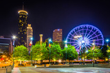 Ferris Wheel and Buildings Seen from Olympic Centennial Park at Night in Atlanta  Georgia