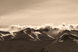 Sepia Evening Winter Mountains and Sunlight Clouds