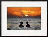 A Couple Watches the Sunset from the Waters Off Waikiki Beach During New Year's Eve in Honolulu