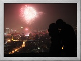 A Couple Kiss as Fireworks Light the Sky During New Year Celebrations in Sarajevo