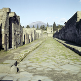 A Pompeii Street with Vesuvius in the Distance  Italy