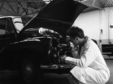 Auto Electrician Changing a Light Bulb on a Morris Minor  Nottingham  Nottinghamshire  1961