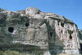 Assyrian Rock Reliefs Pitted by Chr Hermit Caves  Bavian  Iraq  1977