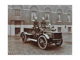 Firemen in Brass Helmets Aboard a Motor Hose Tender  London Fire Brigade Headquarters  London  1909