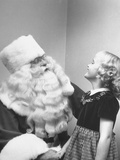 Santa Claus and 5 Year Old Demonstrating Right Way to Hold Child