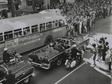 Dallas Crowds Waving as President Kennedy's Limousine Drives Through Downtown Dallas