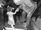 Financier JP Morgan Politely Shakes Hands with a Little Lady  Lya Graf