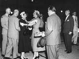 Pat Nixon Embraces Mamie Eisenhower at National Airport