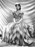Jean Parker  Modeling a Taffeta Frock by Adrian  in Brown and Ivory Plaid  1937