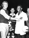 Pele of Santos of Brazil with Bobby Moore  the Halfback of West Ham United  England