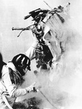 Graham Hill  Lifts Part of the Burning Wreckage to Clear Unconscious Peter Revson