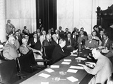The Witnesses and Senators at the Senate Banking and Currency Committee Hearing
