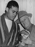 Mike Jacobs Inspects Joe Louis' Fist before the Heavy Weight Champion