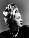 Maria Montez  Modeling a Lilly Dache Turban of Pink  Blue and Green Satin  1945